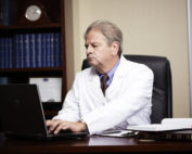 Doctor at a computer during a webinar