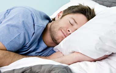 man sleeping bed blanket